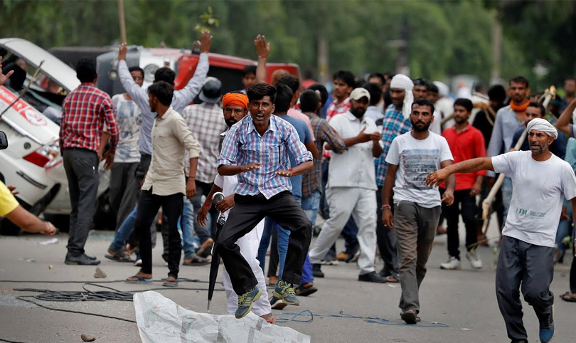 Fatal clashes after Indian guru's rape conviction