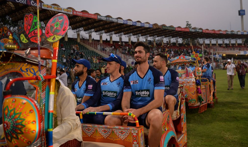 Cricketers Arrives in style in gaddafi Stadium on a decorated rickshaw